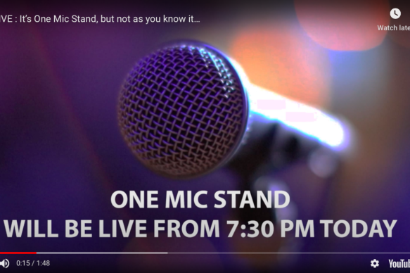 Screenshot from One Mic Stand online, showing a microphone on a purple background.