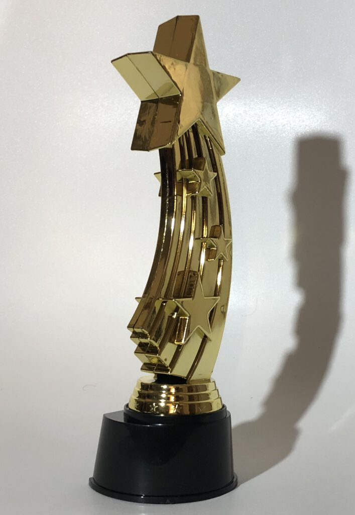 A gold trophy in the shape of a shooting star