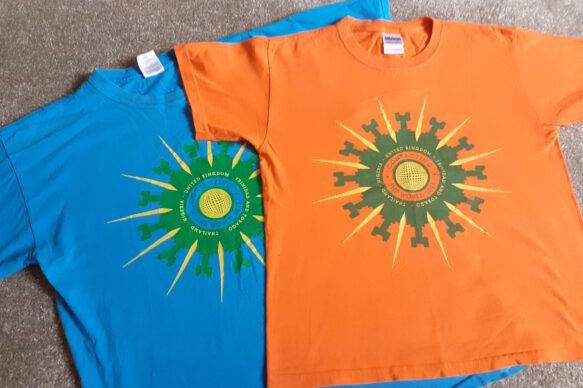 One blue T-shirt and one orange T-shirt with the Contacting the World Festival Logo