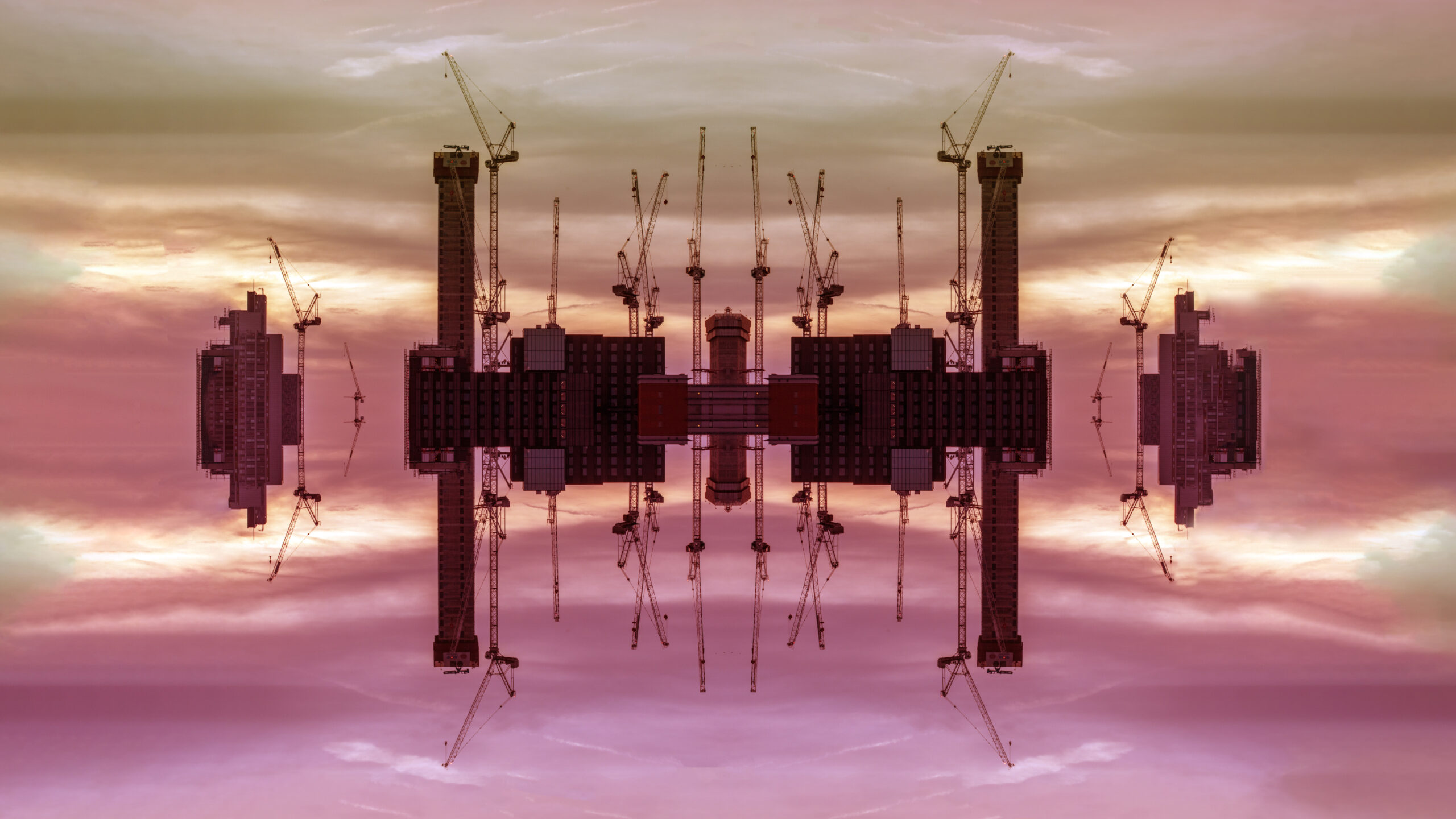 A design made of cranes and buildings against pink clouds