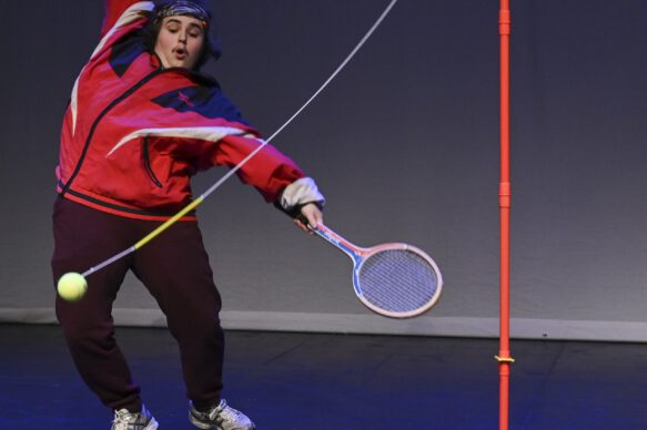 Artist Roma Havers with tennis racquet and ball