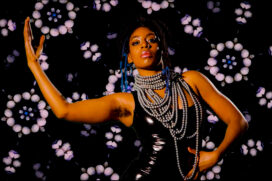 Dancer Mele Broomes against a black and purple background